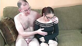 Nerdy redhead gal sucks and rides a cock in the living room
