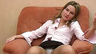 Spreading her legs to show pussy