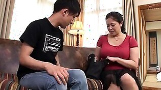Big breasted Japanese mom has a young guy drilling her pussy